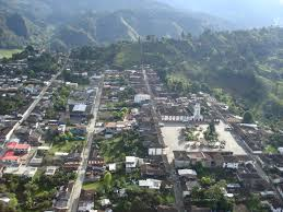 A bird-eye view of the village and surrounding mountains.