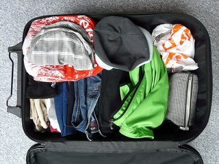 A picture showing a lightly packed carry on.