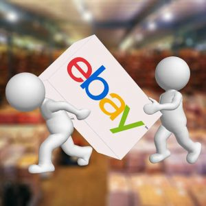 A graphic of two figures carrying an object with the label eBay