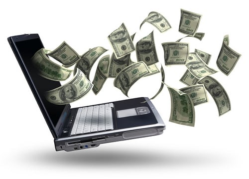 A picture showing money coming out of a laptop screen.