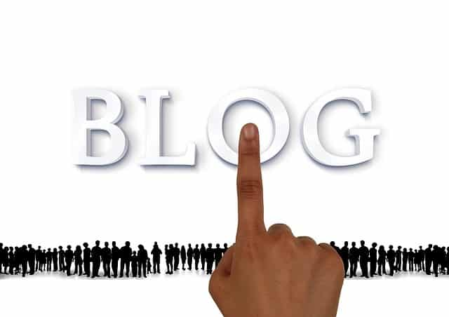 """A graphic of a finger pointing and the text that says """"BLOG""""."""