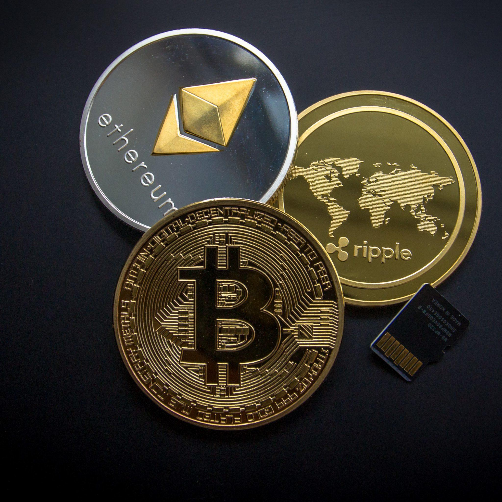A graphic showing tokens of the most popular cryptocurrencies online.